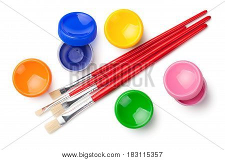 Gouache paints with paint brushes isolated on white background. Top view