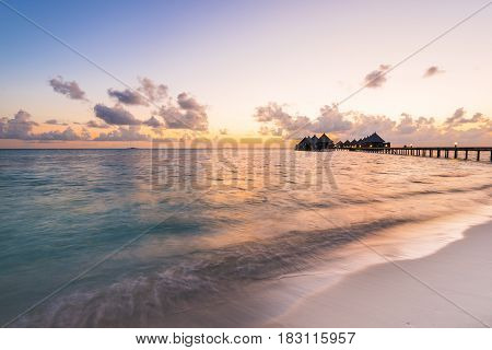 Luxury resort in the Indian Ocean. Relax evening sunset over the ocean. Maldives. Ari Atoll.