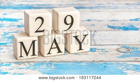 May 29th. Wooden cubes with date of 29 May on old blue wooden background.