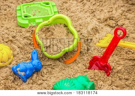 children sandbox with toys in sand, children playground