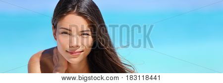 Asian beauty body care banner. Beautiful woman touching neck on blue ocean summer background for skincare treatment or health concept.