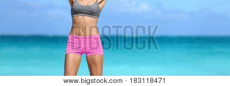 Fit healthy body on ocean background crop banner. Sexy body beach woman showing off slim curves and toned abs. Weight loss success.
