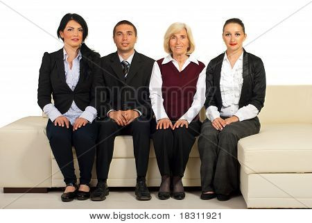 Group Of Business People Sit On Couch