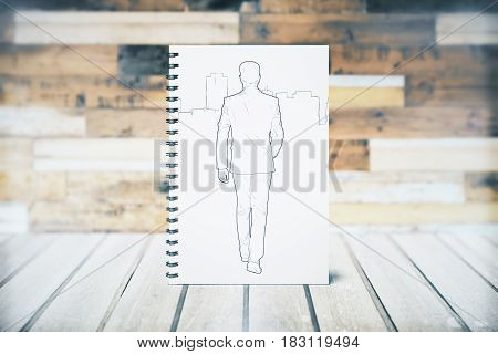 Front view of spiral notepad with walking guy sketch. 3D Rendering