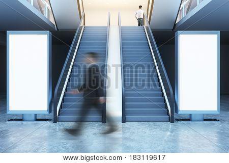 Man Walking Past Billboards