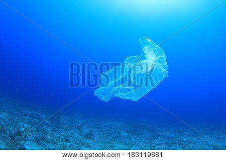 Plastic carrier bag pollution in ocean