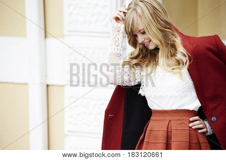 Blond beautiful woman in lace top looking down