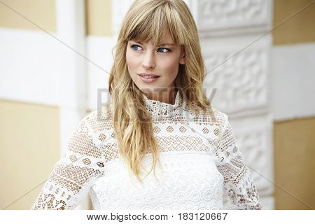 Pretty blond woman in lace top looking away