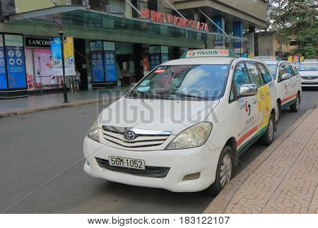 HO CHI MINH CITY VIETNAM - NOVEMBER 27, 2016: Taxis wait for passengers in chinatown Ho Chi Minh City.
