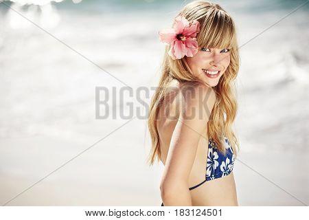 Blue eyed bikini woman wearing flower portrait