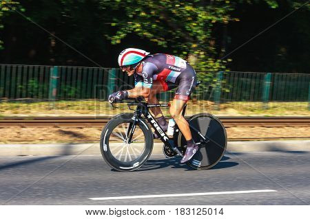 KRAKOW POLAND - AUGUST 3 2013: Unidentified participant of 70th Tour de Pologne cycling 7th stage race in Krakow Poland. Tour de Pologne is the biggest cycling event in Eastern Europe.