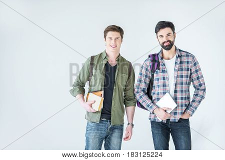 Young Students Holding Books On White With Copy Space