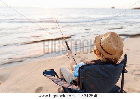 Teenage boy fishing at sea
