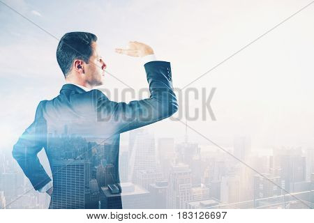 Young man looking into the distance on abstract city background with copy space. Search concept. Double exposure