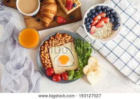 Full English Breakfast With Fried Eggs, Beans, Toasts, Salad, Tomatoes On White Background