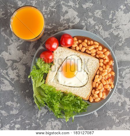 Full English Breakfast With Fried Eggs, Beans, Toasts, Salad, Tomatoes On Gray Background