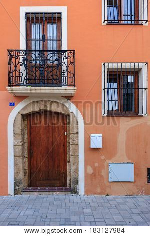 Classic house door and balcony architecture in Italy and Spain