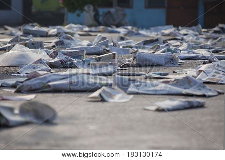 JAKARTA Indonesia. April 20 2017: garbage of old newspaper and plastic in the harbor street