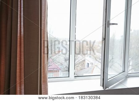 Window and color curtain in room