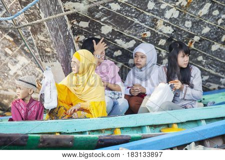 JAKARTA Indonesia. April 18 2017: Muslim people ready to praying in the mosque while sitting in the boat