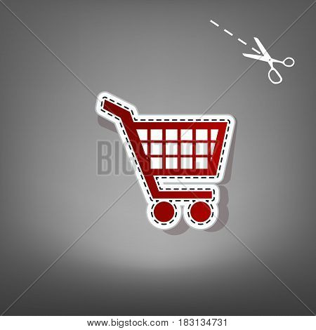 Shopping cart sign. Vector. Red icon with for applique from paper with shadow on gray background with scissors.