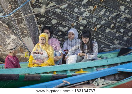 JAKARTA Indonesia. April 18 2017: Muslim people sitting in the boat after praying in the mosque