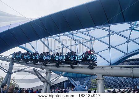 Shanghai China. April 20 2017: Group of people riding TRON Lightcycle Power Run in Shanghai Disneyland China
