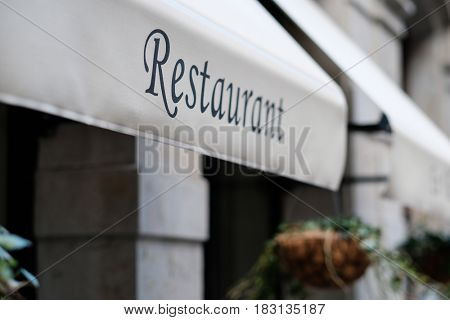 Restaurant sign in Barcelona, Catalonia.