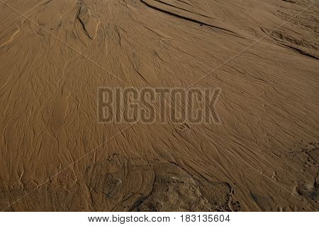 Texture Of River Sand With Traces Of Water Flows