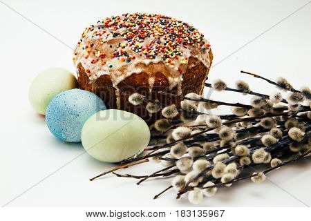 Easter composition on a white background - Easter cake painted eggs willow branches