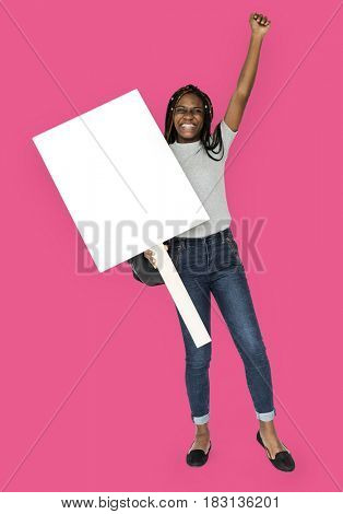 African girl arms raised and holding blank banner
