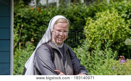 Undefined Nun At Mainau  Island. Germany