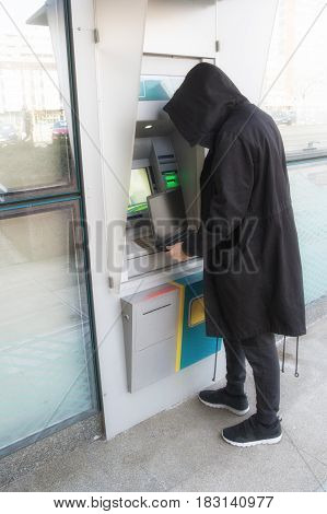 Hacker stealing password and identity on atm machine computer crime