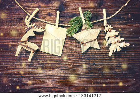 Rustic Christmas decoration on textured wooden background