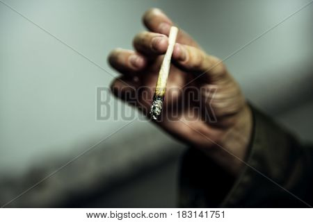 Homeless Man Hand Holding Cigarette