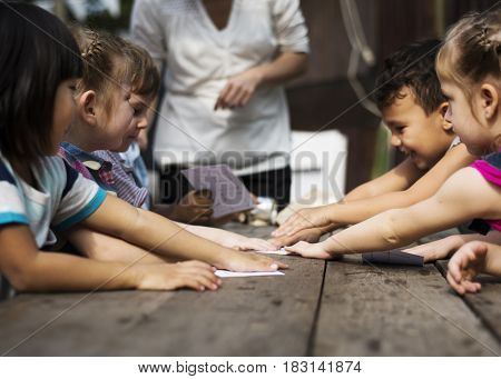 Little Kids Playing Recycle Words Game Together