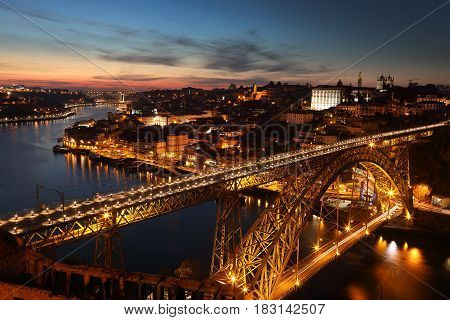 Panoramic view of night Porto with Douro river and Dom Luis I bridge Portugal