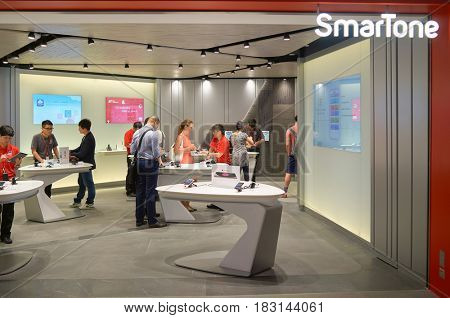 HONG KONG - MAY 05, 5015: people at SmarTone shop. SmarTone Telecommunications Holdings Limited is a wireless communications carrier with operating subsidiaries in Hong Kong and Macau.