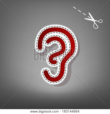 Human anatomy. Ear sign. Vector. Red icon with for applique from paper with shadow on gray background with scissors.