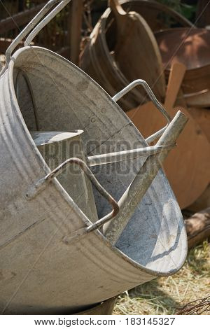 old vat and watering can in the storage