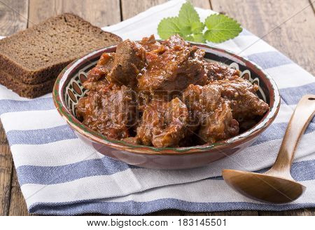 Beef stew with tomato and herbs. Goulash.