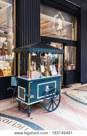 Paris France - August 25 2015: Ice cream vintage wooden vendor handcart on the sidewalk in Paris