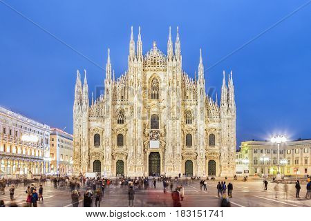 Milan Cathedral, Duomo di Milano. Famous gothic cathedral church of Milan, Italy, Europe. Black and white image shot at dusk from square full of people. poster