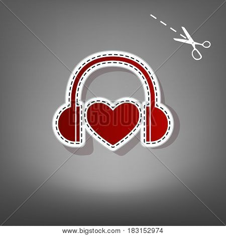 Headphones with heart. Vector. Red icon with for applique from paper with shadow on gray background with scissors.