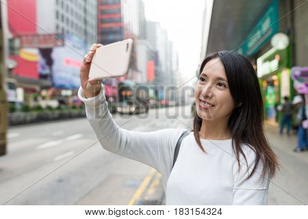 Woman travel in Hong Kong and taking photo
