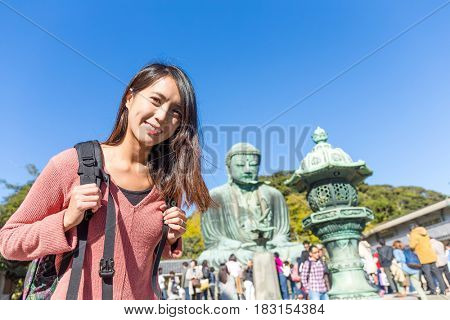 Young woman visit Daibutsu in Kamakura of Japan