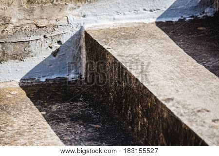 Weathered Concrete Steps In Harsh Sunlight - Diagonal Closeup.