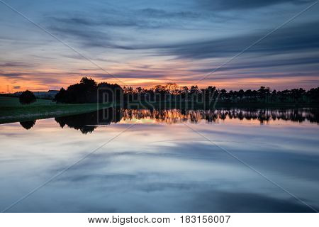 Twilight at Whittle Dene Reservoir - Whittle Dene Reservoir in Northumberland is a popular place for fishing seen here in twilight reflecting the sky