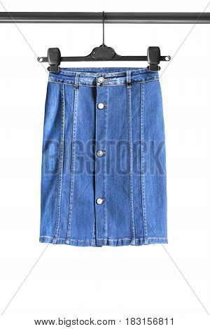 Blue denim pencil skirt on clothes rack isolated over white
