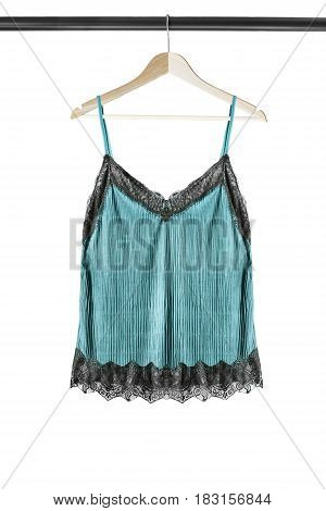 Blue satin lingerie top on wooden clothes rack isolated over white